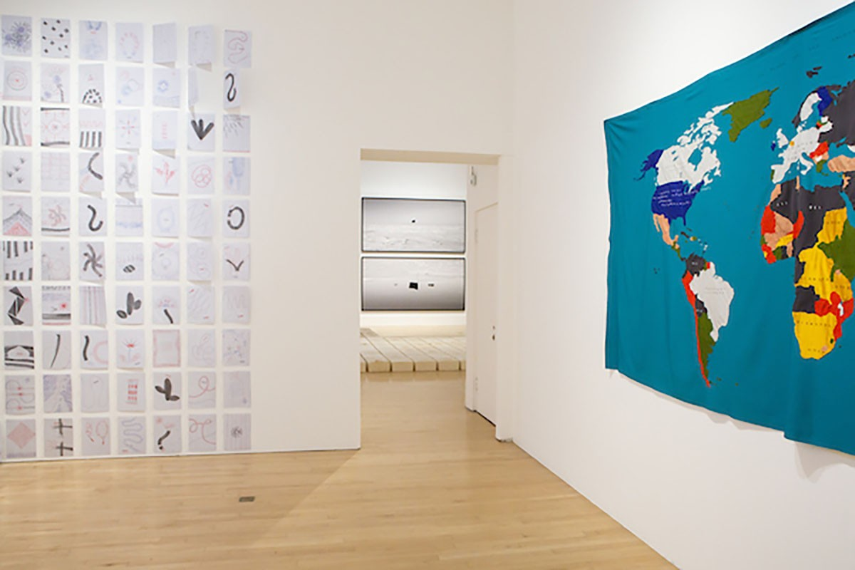 From left to right: Amalia Pica, 'Joy in Paperwork', 2016. 402 digital prints in poly pockets. Mona Vatamanu & Florin Tudor, 'Le monde et les choses', 2014.  Textiles. Installation view, Borderlines, 2019. Image courtesy Talbot Rice Gallery, The University of Edinburgh.