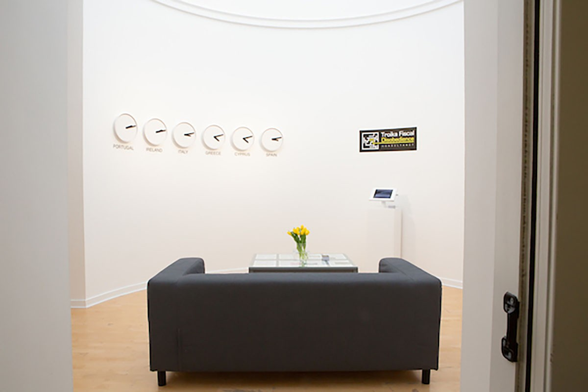 Nuria Guell, 'Troika Fiscal Disobedience Consultancy', 2016/2019. Installation including clocks, furniture, business cards, website and information panels, Borderlines, 2019. Image courtesy Talbot Rice Gallery, The University of Edinburgh.