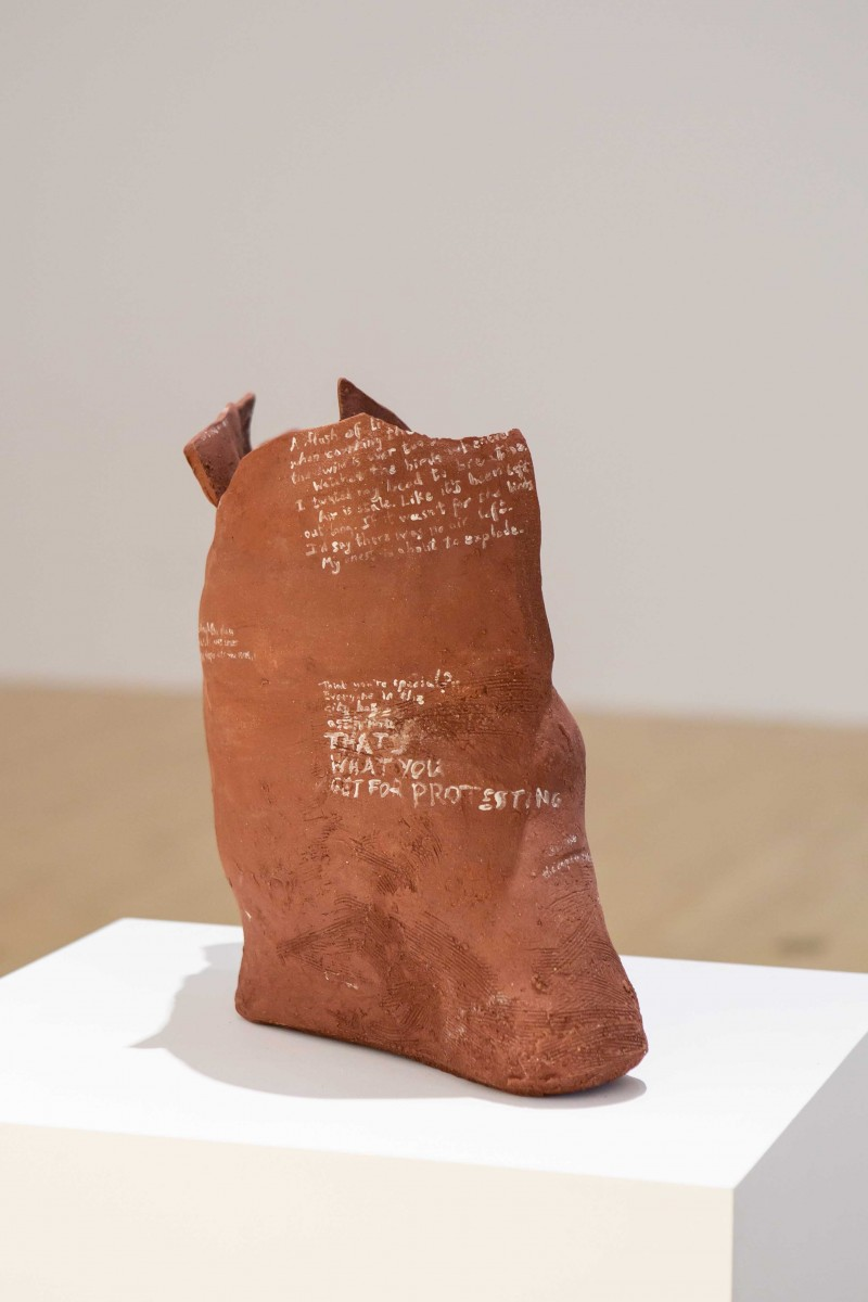 Mohamed Tonsy, 'Gawabat', 2019. Red clay ceramic vessal with etched text. Installation view. Image courtesy of Talbot Rice Gallery, The University of Edinburgh.